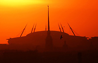 April 23rd 2018, ST PETERSBURG, RUSSIA; Sun setting over Saint Petersburg Stadium, a venue for 2018 FIFA World Cup matches, and the spire of the Peter and Paul Cathedral.