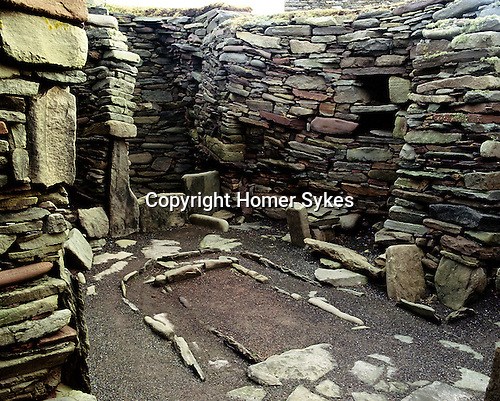Jarlshof Bronze Age House, Sumburgh, Shetland, Scotland. Celtic Britain published by Orion.  Jarlshof Bronze Age settlement was first settled by Neolithic man, and then Bronze Age and Iron Age people, also during the Viking occupation and intermittently up to the sixteenth centuary. Its a British Pompeii on the edge of the sea. The site was lost below a blanket of sand untill a storm in 1897 re exposed parts of the settlement.