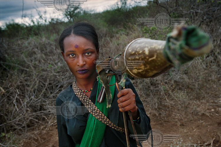 Oromo Liberation Front (OLF) fighter Nuria Hassan, 23, poses with her Rocket Propelled Grenade (RPG) thrower. Nuria is from the nomadic Borana tribe and became a soldier at the age of 20. About one in seven or eight OLF fighters are women..The OLF have been fighting a ?forgotten war? against successive Ethiopian governments since the 1970s. Their aim is independence for Oromia and its 30 million strong Oromo community.