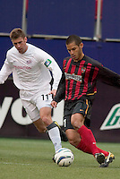 New England Revolution's Pat Noonan marks the MetroStars' Craig Ziadie. The New England Revolution played the NY/NJ MetroStars to a 1 to 1 tie at Giant's Stadium, East Rutherford, NJ, on April 25, 2004.