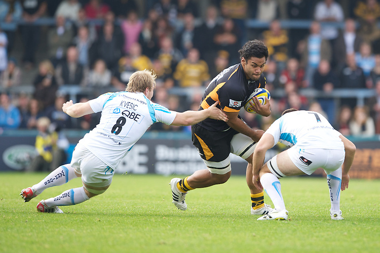 Billy Vunipola of London Wasps charges into Matt Kvesic (left) and Sam Betty of Worcester Warriors during the Aviva Premiership match between London Wasps and Worcester Warriors at Adams Park on Sunday 7th October 2012 (Photo by Rob Munro)