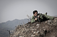 A KIA soldier throws himself to the ground as he executes combat training operations at the highest top mountains in Maiya Jang front line, the second largest city under control of the Kachin Independence Army. The KIA positions around the city have been attacked by shelling and heavy artillery during months. Fierce clashes have taken place since the ceasefire was broken out by the Burmese army last June 2011. During months the fighting were spread out along the Kachin State leaving more than 40,000 displaced persons and refugees (a conservative estimating) in accord with the humanitarian aid groups.