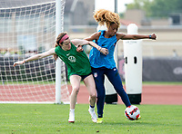 CLEVELAND, OH - SEPTEMBER 14: Rose Lavelle and Casey Krueger of the United States fight for the ball during a training session at the training fields on September 14, 2021 in Cleveland, Ohio.