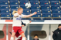 FOXBOROUGH, MA - OCTOBER 16: Derek Waldeck #18 of North Texas SC heads the ball during a game between North Texas SC and New England Revolution II at Gillette Stadium on October 16, 2020 in Foxborough, Massachusetts.