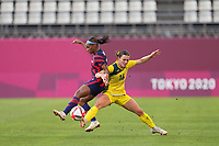 KASHIMA, JAPAN - AUGUST 5: Crystal Dunn #2 of the United States battles for the ball with Hayley Raso #16 of Australia during a game between Australia and USWNT at Kashima Soccer Stadium on August 5, 2021 in Kashima, Japan.