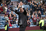 Burnley 1 West Ham United 3, 18/10/2014. Turf Moor, Premier League. Visiting manager Sam Allardyce applauding his team's fans at the end of West Ham United's match with Burnley in an English Premier League match at Turf Moor. The fixture was won by the visitors by three goals to one watched by 18,936 spectators. The defeat meant that Burnley still had not won a league match since being promoted from the Championship the previous season. Photo by Colin McPherson.