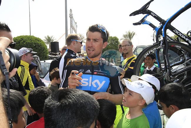 Sky Procycling rider Bernhard Eisel (AUT) signs autographs for local school children before the start of the 3rd Stage of the 2012 Tour of Qatar running 146.5km from Dukhan Souq, Dukhan to Al Gharafa, Qatar. 7th February 2012.<br /> (Photo Eoin Clarke/Newsfile)