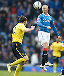 Kenny Miller wins the ball before Declan Gallagher