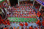 """Pictured: Tens of thousands of Hindu worshipers gather on dozens of floors to celebrate Rakher Upobash, last night, (Tuesday 10th), a fasting festival at Lokenath Brahmachari Temple in Dhaka , Bangladesh.The festival is held on every Saturday and Tuesday during the last 15 days in the month of """"Kartik"""" in the Bengali calendar.Lighting small lamps, also known as Prodips, and special incense, Hindu worshipers fast and pray in earnest to the gods for favours during this  traditional ritual called Kartik Brati or Rakher Upobash. Lokenath Brahmachari, mostly known as Baba Lokenath, was an 18th Century Hindu saint and philosopher in Bengal.<br /> <br /> Please byline: Momo Mustafa/Solent News<br /> <br /> © Momo Mustafa/Solent News & Photo Agency<br /> UK +44 (0) 2380 458800"""
