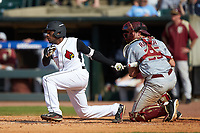 Devin Hairston (29) of the Louisville Cardinals follows through on his swing against the Florida State Seminoles in Game Eleven of the 2017 ACC Baseball Championship at Louisville Slugger Field on May 26, 2017 in Louisville, Kentucky. The Seminoles defeated the Cardinals 6-2. (Brian Westerholt/Four Seam Images)