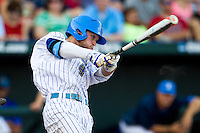 UCLA outfielder Eric Filia (4) swings the bat during Game 12 of the 2013 Men's College World Series against the North Carolina Tar Heels on June 21, 2013 at TD Ameritrade Park in Omaha, Nebraska. The Bruins defeated the Tar Heels 4-1, to reach the CWS Final and eliminate North Carolina from the tournament. (Andrew Woolley/Four Seam Images)