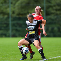 Ulrike De Frere (31) of Eendracht Aalst and Zoe Van Eynde (14) of Standard  battle for the ball during a female soccer game between Standard Femina de Liege and Eendracht Aalst dames on the fourth matchday in the 2021 - 2022 season of the Belgian Scooore Womens Super League , Saturday 11 th of September 2021  in Angleur , Belgium . PHOTO SPORTPIX | BERNARD GILLET