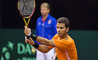 September 09, 2014,Netherlands, Amsterdam, Ziggo Dome, Davis Cup Netherlands-Croatia, Training Dutch Team, Jean-Julien Rojer with in the background captain Jan Siemerink<br /> Photo: Tennisimages/Henk Koster