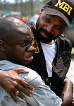Troy Lee, left, embraces his friend Bay St. Louis, Miss., police officer Joel Wallace after discovering he had survived Hurricane Katrina, Wednesday, Aug. 31, 2005, in Waveland, Miss.