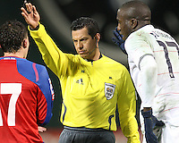 Referee Benito Archundia moves Jozy Altidore #17 of the USA and Pablo Herrera #17 of Costa Rica during a 2010 World Cup qualifying match in the CONCACAF region at RFK Stadium on October 14 2009, in Washington D.C.The match ended in a 2-2 tie.