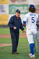 A war veteran is greeted by infielder Ronny Brito (5) after throwing a ceremonial pitch between innings during a Pioneer League game between the Ogden Raptors and the Great Falls Voyagers at Lindquist Field on August 23, 2018 in Ogden, Utah. The Ogden Raptors defeated the Great Falls Voyagers by a score of 8-7. (Zachary Lucy/Four Seam Images)