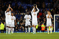 Liverpool, UK. Saturday 01 November 2014<br /> Pictured L-R: Swansea players Ashley Williams, Ki Sung Yueng and Thomas Carroll thank their away supporters as they walk off the pitch after the end of the game. <br /> Re: Premier League Everton v Swansea City FC at Goodison Park, Liverpool, Merseyside, UK.