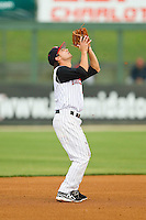 Kannapolis Intimidators shortstop Michael Johnson (5) settles under a pop fly during the South Atlantic League game against the Hagerstown Suns at CMC-Northeast Stadium on May 16, 2013 in Kannapolis, North Carolina.  The Suns defeated the Intimidators 10-7.   (Brian Westerholt/Four Seam Images)
