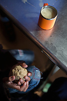 A blind Tibetan student holds a piece of Tsampa, a traditional local food, during breakfast at the canteen of the School for the Blind in Tibet, in the capital city of Lhasa, September 2016.