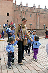 Mother & Children In Plaza De Armas