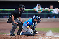 Myrtle Beach Pelicans catcher Raymond Pena (35) blocks a pitch in the dirt as home plate umpire Mike Mackey looks on during the game against the Lynchburg Hillcats at Bank of the James Stadium on May 22, 2021 in Lynchburg, Virginia. (Brian Westerholt/Four Seam Images)
