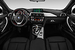 Stock photo of straight dashboard view of 2018 BMW 3-Series 330e-iPerformance 4 Door Sedan Dashboard