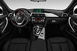 Stock photo of straight dashboard view of 2018 BMW 3-Series 330e-iPerformance 4 Door Sedan Dashboard