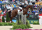 Caroline Powell and Mac MacDonald of New Zealand compete in the final stadium jumping round of the FEI  World Eventing Championship at the Alltech World Equestrian Games in Lexington, Kentucky.
