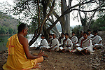 Students of Om Shantidhama during a Vedic class on the bank of Cauvery river. Om Shantidhama is a residential vedic school for boys. Nestled among the confluence of hills, forest and rivers - Om Shanti Dhama is a world removed from the maddeningly fast and often chaotic urban India. Students from allover the country are selected to take part in its Vedic and free education system. What is unique about this institute is that they have blended the traditional and modern education system. Here computer and science is taught with the same passion as the Vedas and Shastras, helping the students to grow spiritually as well as earn a living. Bonding with the nature and animal world is a mandatory part of the institute's curriculum. Karnataka, India. Arindam Mukherjee