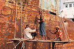 Hundreds of men earn a meagre living in the shipyards of Old Dhaka, on the banks of the Buriganga River. Safety standards are  low, and the working conditions are difficult.