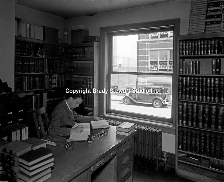 Pittsburgh PA: Student working on a project at the library, Duquesne University.<br /> Brady Stewart was hired to photography the campus, classrooms and offices for a publication to increase enrollment at the Catholic University.