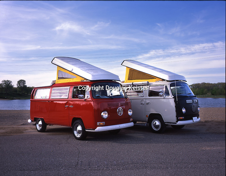 Two 1969 Volkswagen Westfalias exhibit their pop-up sleeping compartments. John and Mary Jane Merschdorf own the pearl white van. Chuck and Donna Simpson own the red van. Both were photographed in Camp Dearborn, Michigan.<br /> <br /> It's safe to say that the most well-known and enduring imported vehicle is the humble Volkswagen. The beginnings of the Volkswagen can be traced to arch bad guy Adolf Hitler, who desired an affordable automobile for the German people. One of Hitler's goals for his new society was to build autobahns modeled after wide American roadways. But what good would his autobahns be without vehicles? At the time, the only people who had automobiles were wealthy Germans, yet there were very few of these folks. In 1934, Hitler personally proscribed the design specifications of what would be known as the people's car, the volks wagen. Ultimately, the design was turned over to Dr. Ferdinand Porsche, who would go on to design the renowned sports cars that carry his name. The first Porsche-designed Volkswagen rolled off the assembly line on August 15, 1940, and production continued throughout World War II. Most of the units produced during the war were German army vehicles known as Kubelwagens and amphibious vehicles known as Schwimmwagens. Despite the widespread destruction of German industries by the Allies, the Volkswagen factory, located in Wolfburg, Germany, was up and running by late 1945. In 1947, the first Beetle was offered to the public. <br /><br />By the late 1940s, Volkswagen designers were looking into the possibility of building a larger van-like vehicle. The original design is credited to Ben Pod, a Volkswagen importer from the Netherlands who sketched his design on a cocktail napkin in April 1947. By 1949, eight bus prototypes known as Transporters, or Bullis, were tested, all powered by a modest 25-horsepower engine. Six of these of these were dubbed Panelvans, another was called a Kombi, and the eighth was named a Microbus. The Trans