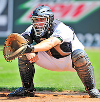 15 July 2010: Vermont Lake Monsters' catcher David Freitas warms his pitcher up prior to a game against the Aberdeen IronBirds at Centennial Field in Burlington, Vermont. The Lake Monsters rallied in the bottom of the 9th inning to defeat the IronBirds 7-6 notching their league leading 20th win of the 2010 NY Penn League season. Mandatory Credit: Ed Wolfstein Photo