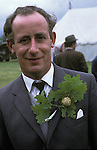 Grovely Forest Right. Wishford Magna, Wiltshire England. Oak Apple Day, May 29th.  A member ofthe village fete committe wears an oak apple in his button hole. 1970s UK