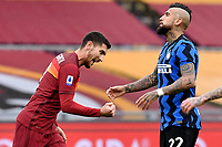 Lorenzo Pellegrini of AS Roma celebrates, while Arturo Vidal of FC Internazionale lookd dejected, after scoring the goal of 1-0 during the Serie A football match between AS Roma and FC Internazionale at Olimpico stadium in Roma (Italy), January 10th, 2021. Photo Andrea Staccioli / Insidefoto