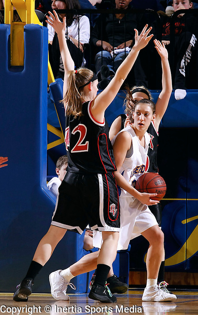 BROOKINGS, SD - March 13th, 2009 : Alison Kusler of Aberdeen Central finds herself in a tight spot between two Brandon Valley defenders Kelli Hoff and Heidi Hoff during their game Friday evening in the 2009 State AA Girls Basketball Tournament in Frost Arena on the campus of South Dakota State University in Brookings, SD. (Photo By Ty Carlson/Inertia)