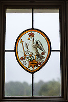 UK, England, Yorkshire.  Stained Glass Herald of Anne Boleyn, a Crowned Falcon Holding a Sceptre.