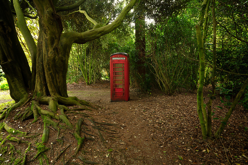 Old english phone booth. Trewidden Gardens, Cornwall, England