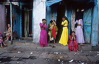 INDIA Mumbai, prostitutes in front of so called cages the brothels in redlight district Falkland Road in Megacity Bombay / INDIEN Mumbai, Prostituierte vor einem Bordell ( auch Kaefige genannt) im Rotlichtbezirk Falkland Road in Megacity Metropole Bombay