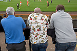 Berwick Rangers 5 East Stirlingshire 0, 23/08/2014. Shielfield Park, Scottish League Two. Three men watching the first half at Shielfield Park, during the Scottish League Two fixture between Berwick Rangers and East Stirlingshire (orange shirts). The home club occupied a unique position in Scottish football as they are based in Berwick-upon-Tweed, which lies a few miles inside England. Berwick won the match by 5-0, watched by a crowd of 509. Photo by Colin McPherson.