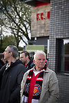 FC United of Manchester 0 Benfica 1, 29/05/2015. Broadhurst Park, Stadium Opening. Fans gathering outside the main stand at Broadhurst Park, Manchester, the new home of FC United of Manchester before the club's match against Benfica, champions of Portugal, which marked the official opening of their new stadium. FC United Manchester were formed in 2005 by fans disillusioned by the takeover of Manchester United by the Glazer family from America. The club gained several promotions and played in National League North in the 2015-16 season, but lost this match 1-0. Photo by Colin McPherson.