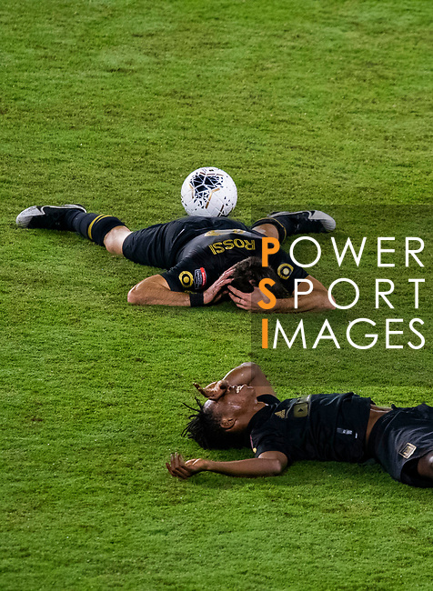 Latif Blessing and Diego Rossi of Los Angeles FC (USA) lie on the field after being tackled by Tigres UANL (MEX) players during their CONCACAF Champions League Final match at the Orlando's Exploria Stadium on 22 December 2020, in Florida, USA. Photo by Victor Fraile / Power Sport Images