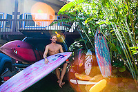 Surfer Robin John loading surfboards into a car before heading to the North Shore, Oahu