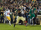 Oct. 22, 2011; George Atkinson III scores a touchdown on a kickoff return vs. USC...Photo by Matt Cashore/University of Notre Dame