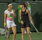Martina Hingis (SUI) and Sania Mirza (IND) defeat Lara Arruabarrena (ESP) and Raluca Olura (ROU) 6-0