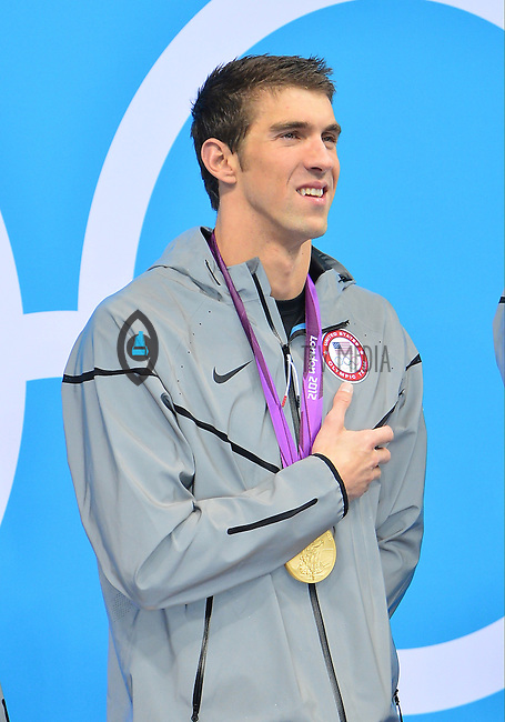August 04, 2012..Michael Phelps listens to the National during award ceremony for 4x100m Medley Relay at the Aquatics Center on day eight of 2012 Olympic Games in London, United Kingdom.
