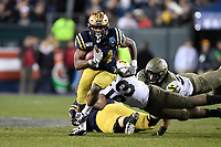 PHILADELPHIA, PA - DEC 14, 2019: Navy Midshipmen fullback Jamale Carothers (34) runs the football during game between Army and Navy at Lincoln Financial Field in Philadelphia, PA. The Midshipmen defeated Army 31-7. (Photo by Phil Peters/Media Images International)