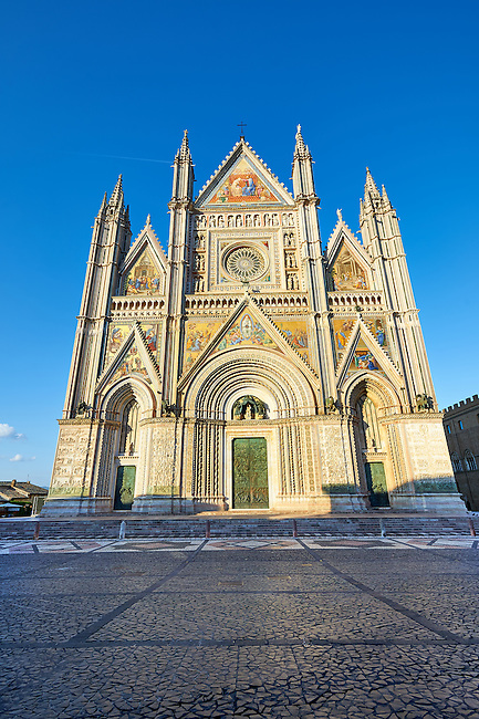 14th century Tuscan Gothic style facade of the Cathedral of Orvieto, designed by Maitani, Umbria, Italy