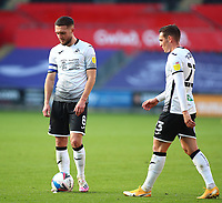 17th October 2020; Liberty Stadium, Swansea, Glamorgan, Wales; English Football League Championship Football, Swansea City versus Huddersfield Town; Matt Grimes and Connor Roberts of Swansea City stand over the ball before a freekick