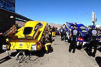 Oct. 28 2011; Las Vegas, NV, USA: NHRA funny car driver Jeff Arend (left) alongside Robert Hight during qualifying for the Big O Tires Nationals at The Strip at Las Vegas Motor Speedway. Mandatory Credit: Mark J. Rebilas-